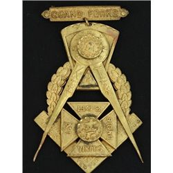 Fine Grand Forks Dak. Territory suspension badge dated Feb 4 1885, cast in gilt bronze with fine det