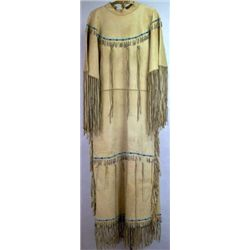 Nicely accomplished Indian beaded dress C. mid 20th century, antolope leather with tin cone dangles,
