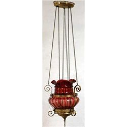 Beautiful 19th C. hall candle hanging lamp with fine cranberry shade and brass frame. Lamp in fine c
