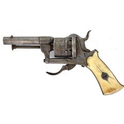 """Unmarked antique pin fire revovler with 2 1/4"""" round barrel and ivory grips, all metal surfaces show"""