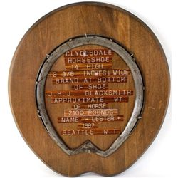 Enormous Clydesdale horseshoe mounted on display board, horseshoe stamped JHJ.
