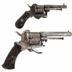 Collection of 2 antique pin fire revolvers includes 7mm with good engraving and black gutta purcha g