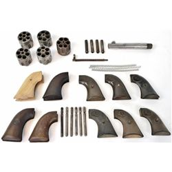 """Misc. Colt parts includes 10 pair of grips, 1 5 1/2"""" .38 cal barrel, 5 cylinders including 2-.45 cal"""