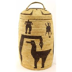 """Papago coiled lidded basket with animal and human effigy's, 18"""" tall. Shows one area of stain approx"""