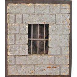 Hand carved wooden wall safe frame carved to represent prisoner behind jail bars. Removed from old V