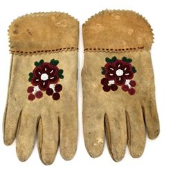 Pair floral beaded leather gauntlets inner cuff area lined in cotton.