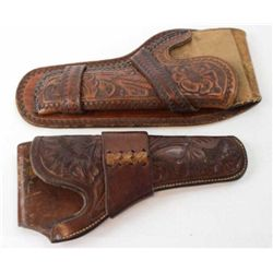 """Collection of 2 holsters includes HH Heiser floral carved single loop for Colt SA 5 1/2"""" catalog 727"""