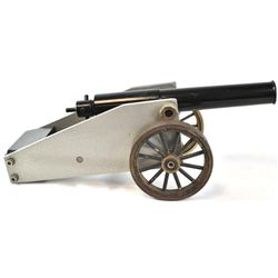 """Unmarked 16 ga. blank firing signal cannon with brass wheels, steel barrel and carriage, 16"""" overall"""