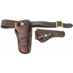 "Collection of leather holsters includes VL&A floral carved holster rig for Colt SA 5 1/2"" with Hunte"