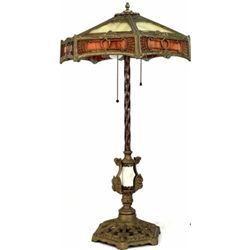 "Antique tall table lamp with colored slag glass shade, alabaster and cast iron base, 30"" tall. Good"