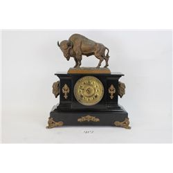 Exceptional Ansonia buffalo statue clock with original clock body in black Japan metal with intricat