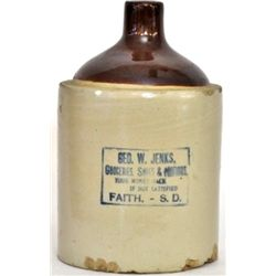 Antique advertising whiskey crock one gallon marked Geo. W. Jenks, Faith, S.D. showing chips to bott