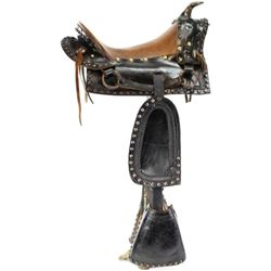 "C. 1900 small childs size saddle in black leather with brass spots, brown leather seat 10 1/2"" with"
