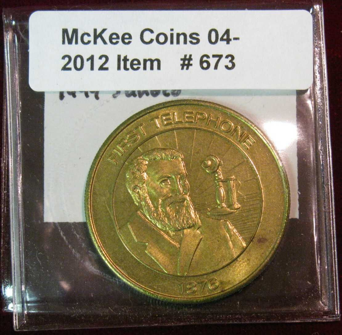 673  1876 First Telephone Medal  1999 Sunoco Millennium Coin