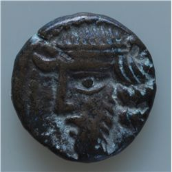 Phraates IV (38-2 BC) - AE-15 diad hd.l. with wavy hair Obv: Archer r. with bow, monogram below 3.9