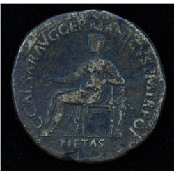 Caligula (37-41 AD) - AE-Sestertius  Rome 40-41 AD. Obv: Pietas seated l., holding patera  and resti