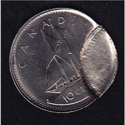 Ten Cent Brockage - Nice error, date unknown. 2.1g.