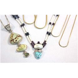 Seven Necklaces, Two With Pendants