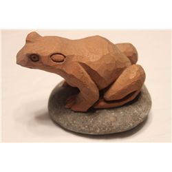 CARVED WOODEN FROG MOUNTED ON STONE POD BY MATTHEW ORANTE - 1979
