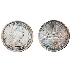 1961. ICCS Mint State-65. Attractive issue and rare date in gem condition. Very light, attractive to
