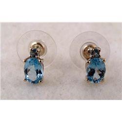 1 PAIR EARRINGS WHITE & YELLOW GOLD LT. BLUE OVAL GEM