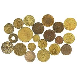 Lot of 21 Canadian copper/brass merchant tokens and medals, mostly late 1800s.