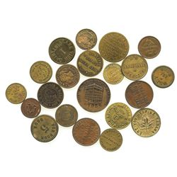 Lot of 21 Canadian copper/brass merchant tokens, mid-1800s to mid-1900s.