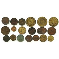 Lot of 19 British copper/brass merchant tokens, ca. 1850-1899.