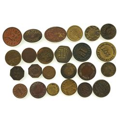 Lot of 24 British copper/brass merchant tokens, ca. 1850-1899.
