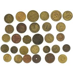 Lot of 30 British copper/brass merchant tokens, ca. 1850-1899.