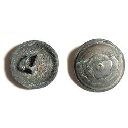 Small, brass uniform button with anchor design, intact but uncleaned.
