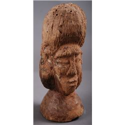 Wood Carving with two faces.…