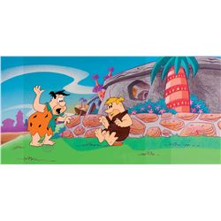 Original production cels of Fred Flintstone and Barney Rubble on production background