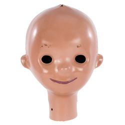 """Child's head from the """"It's a Small World"""" attraction at Disneyland"""