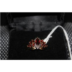 14 K YELLOW GOLD RING WITH LARGE CENTER MARQUIS GARNET AND 10 SIDE GARNETS WITH SMALL DIAMONDS SIZE