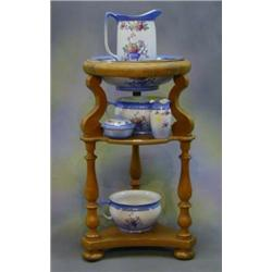 A Continental walnutwood 3 tier wash stand