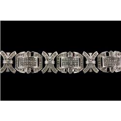 BRACELET: 14KWG (stamped 14K) link bracelet set with 272 round and 256 princess cut diamonds