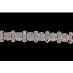 BRACELET: 14KWG bracelet set with round, baguette and princess cut diamonds