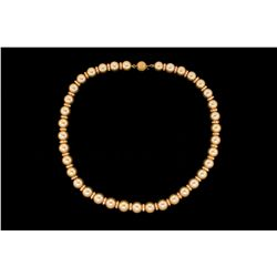 NECKLACE: Single strand necklace of 37 golden south sea pearls and diamonds