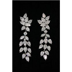 EARRINGS: Pair of platinum earrings set designed and made by Kwiat