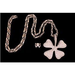 NECKLACE: Platinum fancy link chain and platinum four leaf clover pendant
