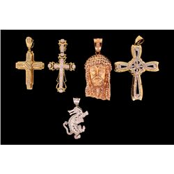 PENDANTS: Men's assorted gold and diamond pendants