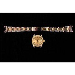 ROLEX: Lady's 14ky Rolex O.P. Date wristwatch