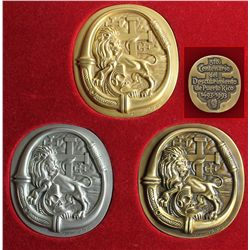 Cased set of 3 bronze oval medals in gold, silver and bronze colors, made by artist Lorenzo Homar (1