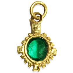Tiny but ornate gold pendant with high-quality cabochon emerald (approx. 1/2 carat).