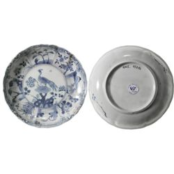Chinese blue-on-white porcelain saucer, Kangxi period, peacock design.
