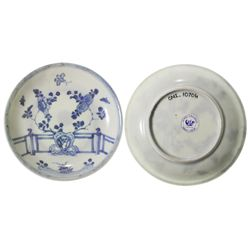 Chinese blue-on-white porcelain saucer, Kangxi period, fence-and-flowers design.