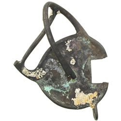 Brass sword hilt (crushed but intact) with patches of encrustation.