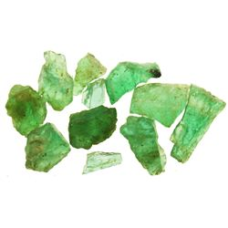 Lot of 11 small natural emeralds up to 1 carat each.
