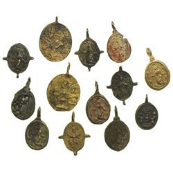 Lot of 13 small, brass religious medallions.